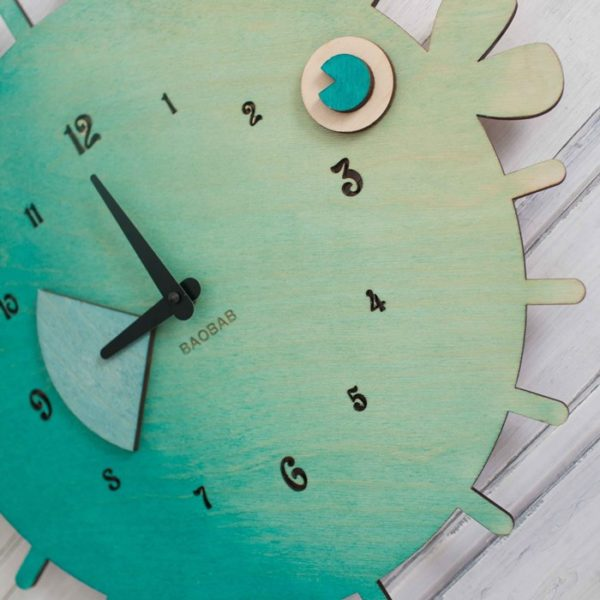 BAOBAB: wall clock made of wood fish ball