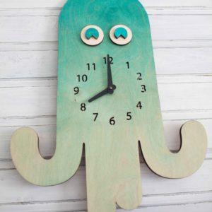 BAOBAB: настенные часы из дерева осьминог